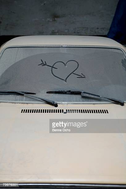 Heart and arrow drawn onto frosted windshield