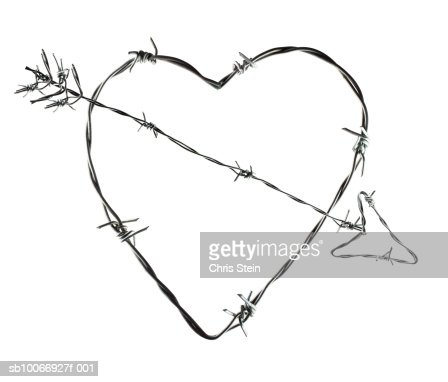 Heart And Arrow Made Of Barbed Wire Stock Photo | Getty Images