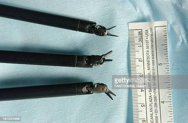 The Revolution Of MiniInvasive Surgery The three minihands LOCATED'the extremity of a robot arm allows to perform surgical procedures''s high...