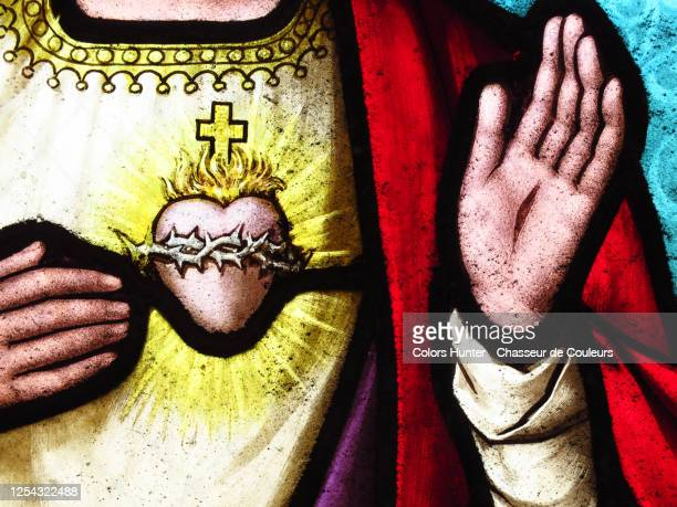 heart and hands of jesus christ on an old stained glass - religious symbol stock pictures, royalty-free photos & images