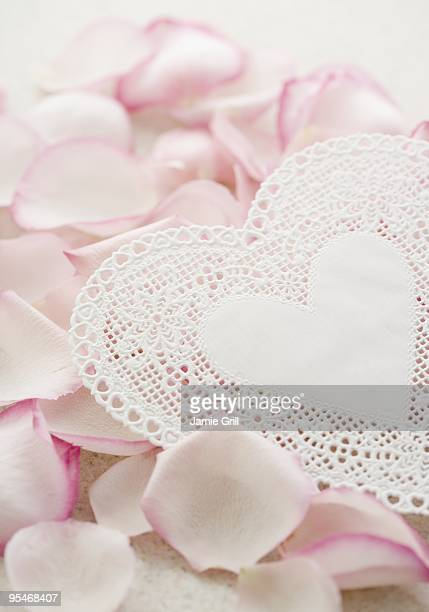heart and rose petals - doily stock photos and pictures