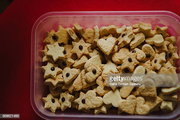 Heart and star-shaped cookies in a box