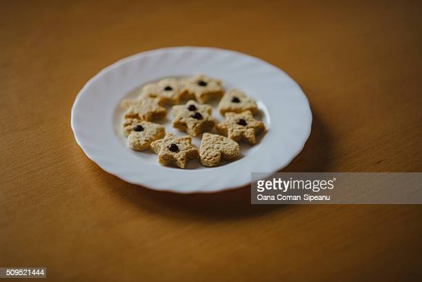 Heart and star-shaped cookies on a plate