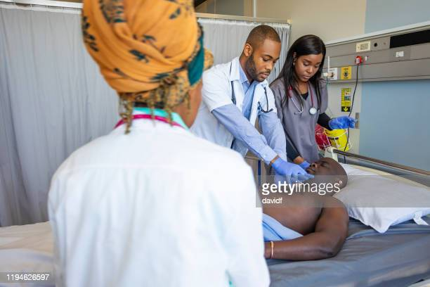 heart attack victim being given resuscitation chest compression - myocardium stock photos and pictures