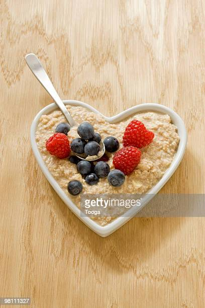 Heart bowl filled with oatmeal and berries