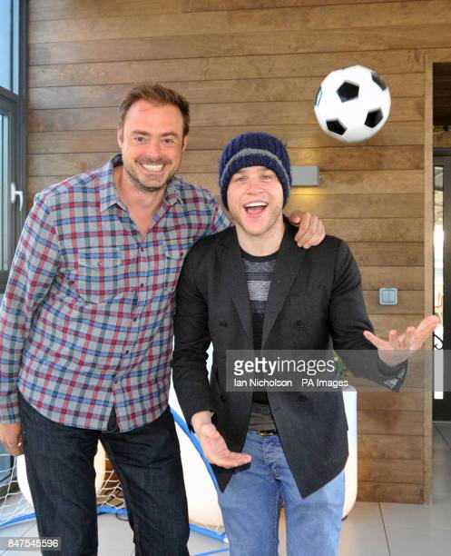 Heart Breakfast Show host Jamie Theakston with guest co-host singer Olly Murs after taking part in a penalty shoot-out at the radio station's London...