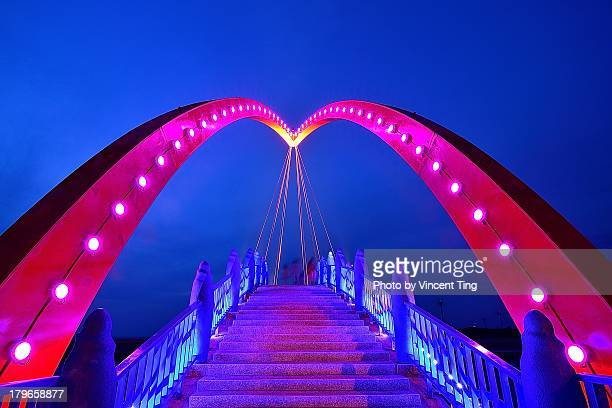 heart bridge - hot pink stock photos and pictures