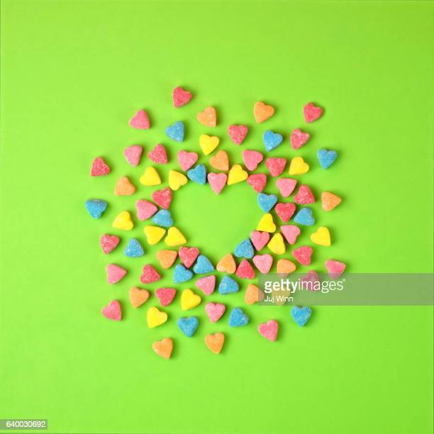 heart candies in the shape of a heart - candy heart stock pictures, royalty-free photos & images