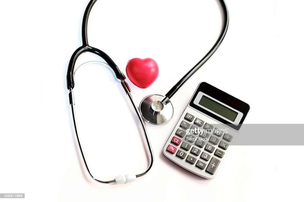 Heart Care and calculator : Stock Photo