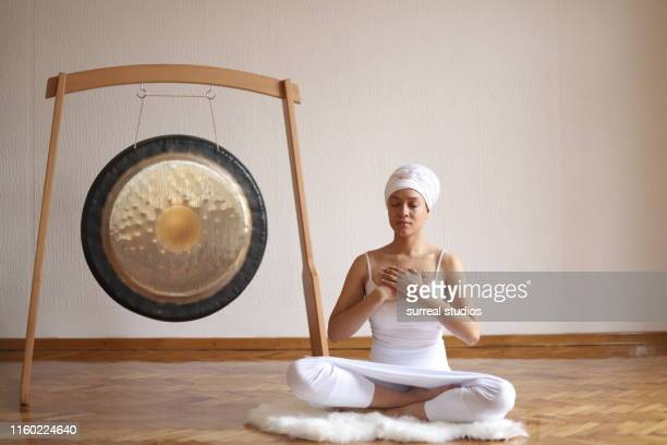 heart chakra meditation - gong stock pictures, royalty-free photos & images