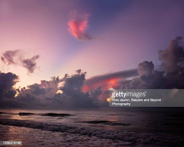 heart cloud and purple sunrise at myrtle beach, south carolina - heart month stock photos and pictures