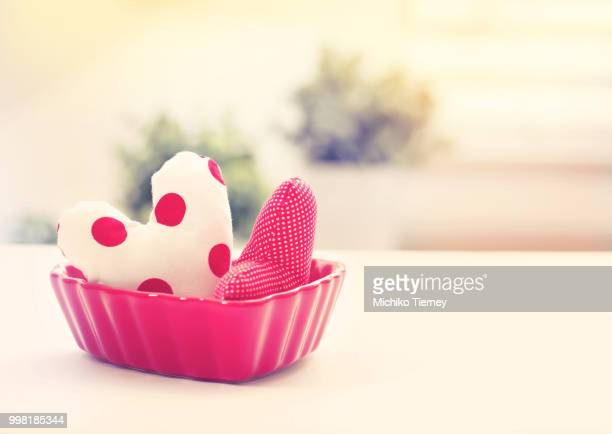 Heart cushions in a red heart dish