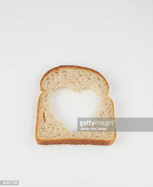 Heart cut into slice of whole wheat bread
