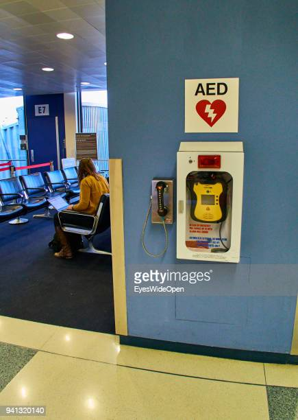 A heart defibrillator and a emergency phone at Salt Lake City International Airport on March 01 2015 in Salt Lake City Utah United States