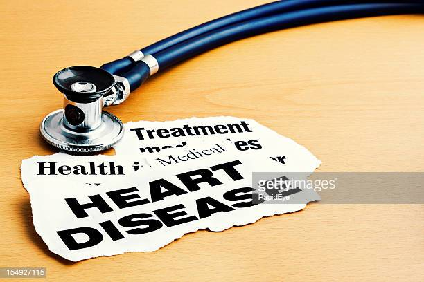 Heart disease newspaper headlines with stethoscope on desk
