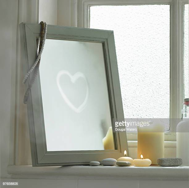 heart drawn on bathroom mirror - vanity mirror stock pictures, royalty-free photos & images