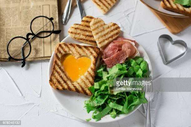 Heart egg on toast bread