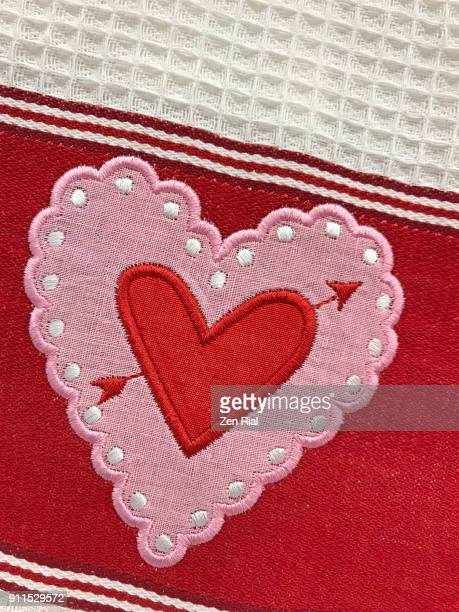 Heart embroidered on fabric