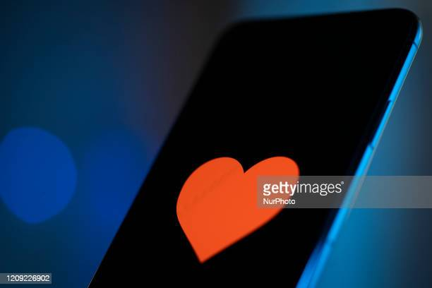 A heart emoji is seen on an iPhone 11 Pro Max in this illustration photo in Warsaw Poland on April 4 2020