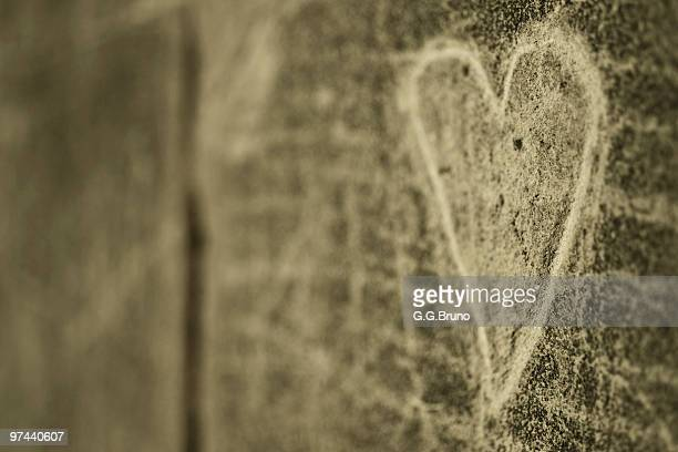 Heart engraved on a wall