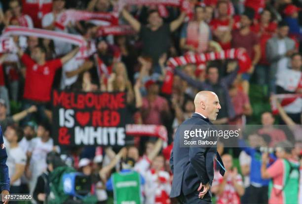 Heart fans in the crowd celebrate as Victory coach Kevin Muscat leaves the field after the Victory lost the round 21 ALeague match between Melbourne...