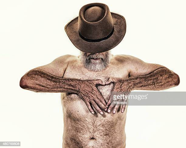 heart finger framing fedora hat senior man - hairy man chest stock photos and pictures