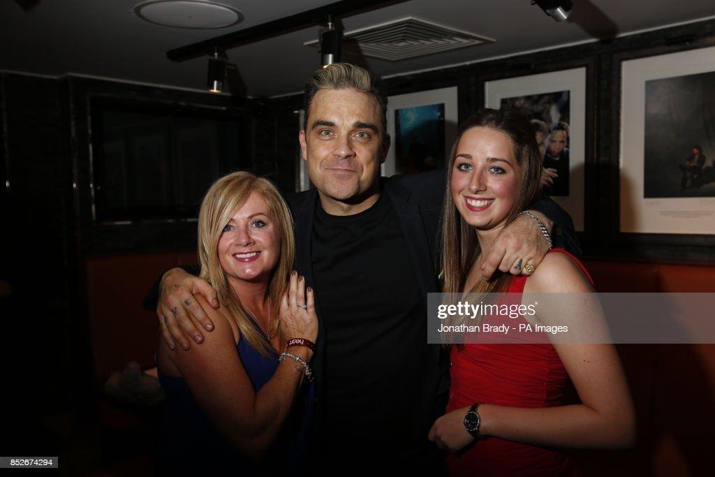 Heart FM contest winners meet Robbie Williams after an