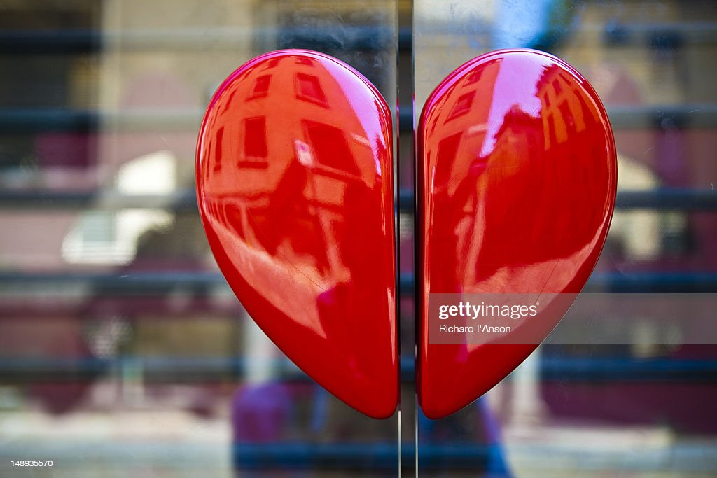 Heart handles on shop door on Via della Spiga. : Stock Photo