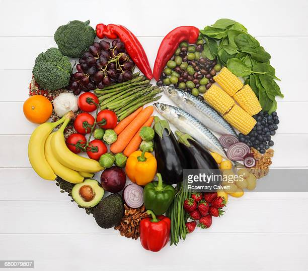 heart healthy mediterranean diet in heart-shape. - nut food stock photos and pictures