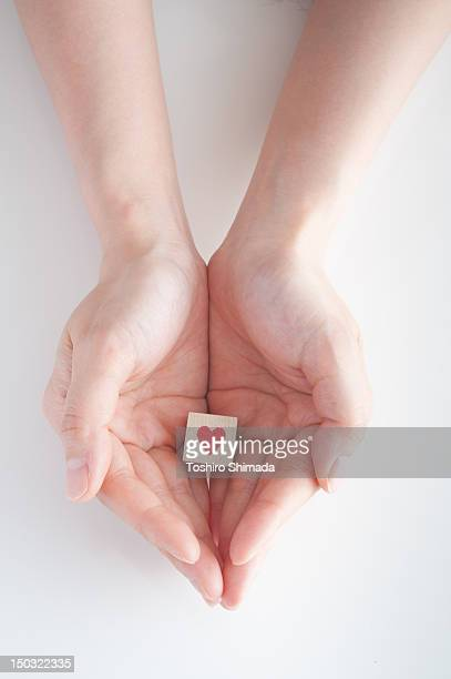 heart in  hand - hands cupped stock pictures, royalty-free photos & images