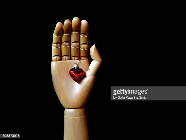heart in hand - aktmodel stock-fotos und bilder