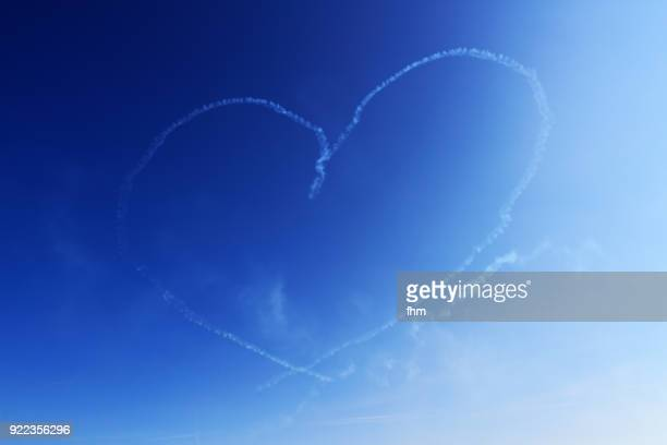 a heart in the sky - heart background stock pictures, royalty-free photos & images