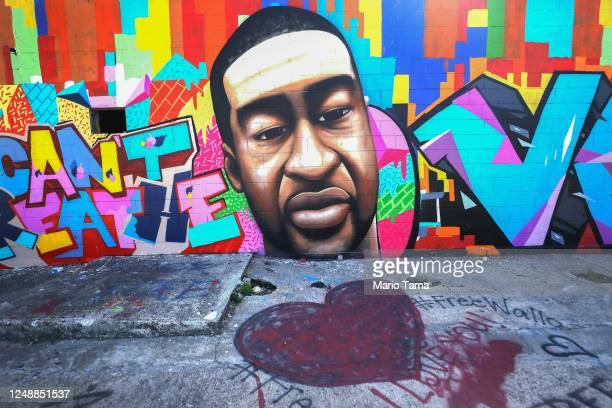 A heart is painted in front of a mural dedicated to George Floyd located a couple of miles from where Floyd grew up in Houston's Third Ward on June...