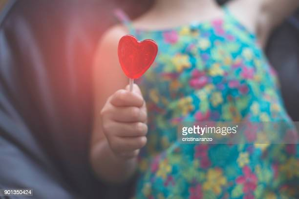 heart lollipop - organ donation stock photos and pictures