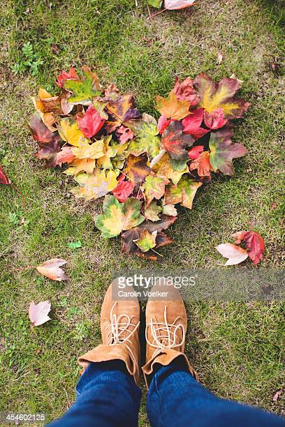 Heart made of fall leafs and leather boots