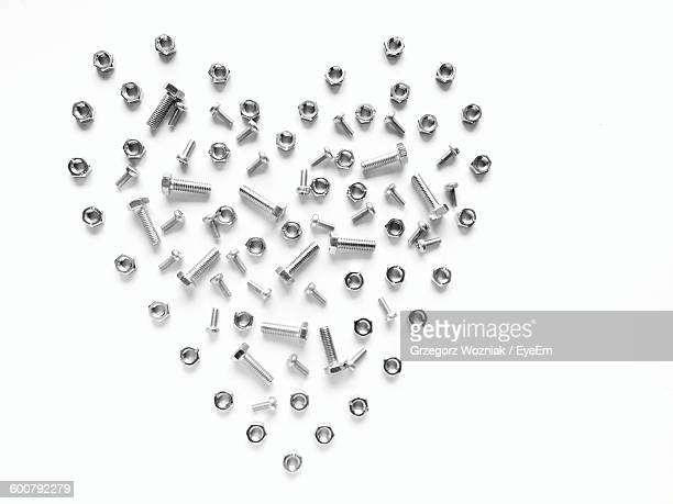 Heart Made Of Nuts And Bolts Against White Background