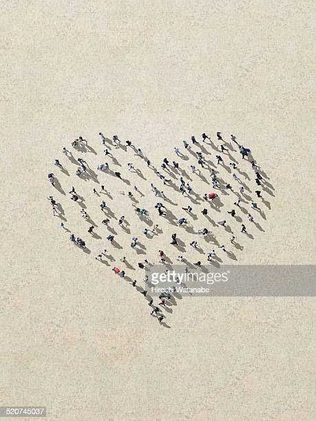 Heart made out of walking men and women