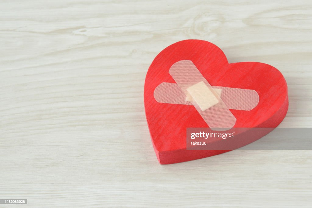 Heart object with adhesive plaster : Stock Photo