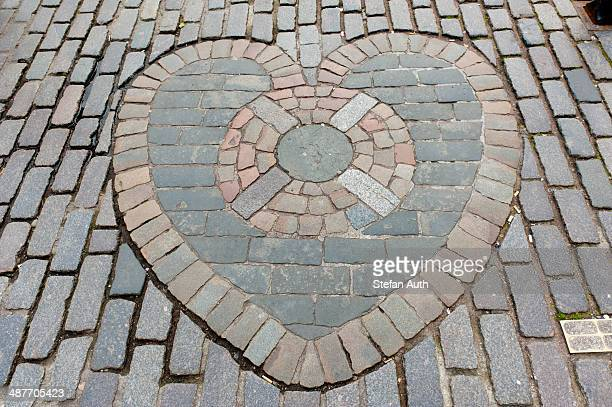 Heart of Midlothian, paving stones mosaic in front of St. Giles' Cathedral, High Street, Royal Mile, Edinburgh, Scotland, United Kingdom