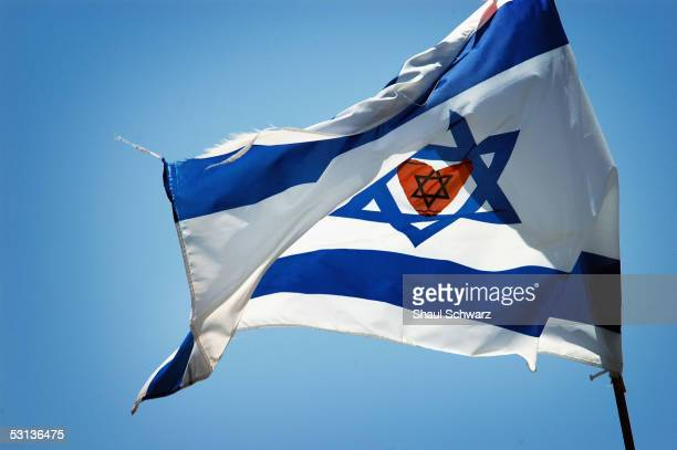 A heart of orange is placed in the center of a Israeli flag June 23 2005 above a house in Gani Tal settlement in Gush Katif Gaza Strip Orange has...