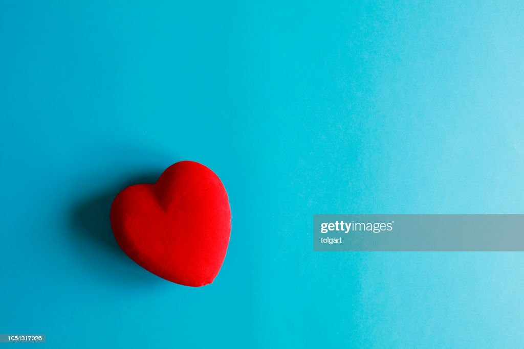 Heart on a blue paper background : Stock Photo