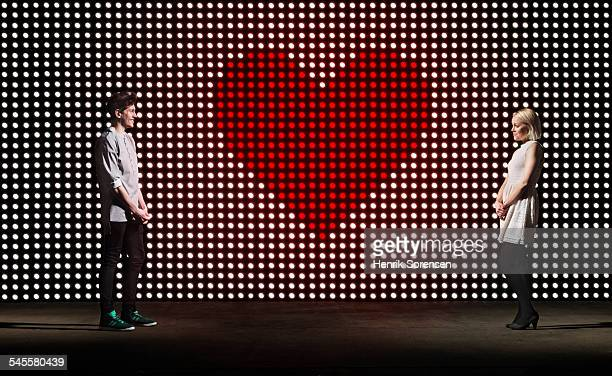 heart on lightwall - dating stock pictures, royalty-free photos & images