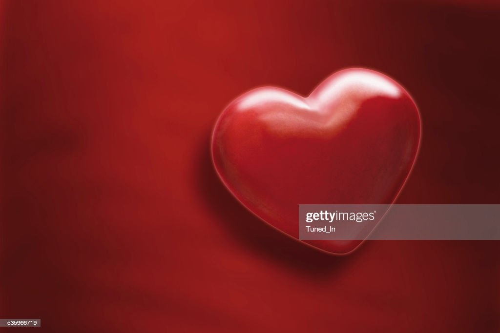Heart on red background, close up : Stock Photo