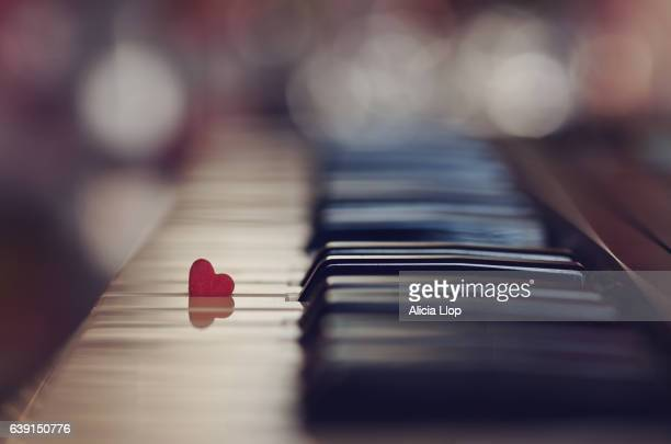 heart on the piano - classical stock pictures, royalty-free photos & images