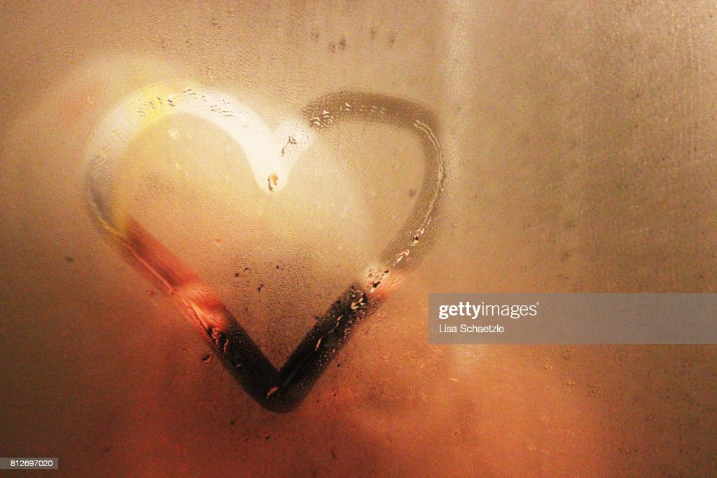 Heart painted on bathroom mirror : Stock Photo