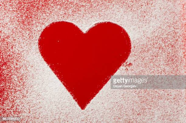 heart pattern on the bottom of a red bowl - animal internal organ stock photos and pictures