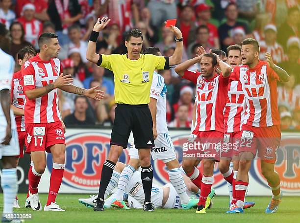 Heart players react as referee Ben Williams gives Patrick Kisnorbo of the Heart a red card after he fouled Connor Pain of the Victory during the...