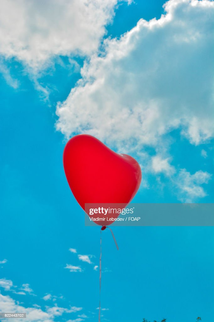 Heart shape balloon flying in sky : Stock Photo