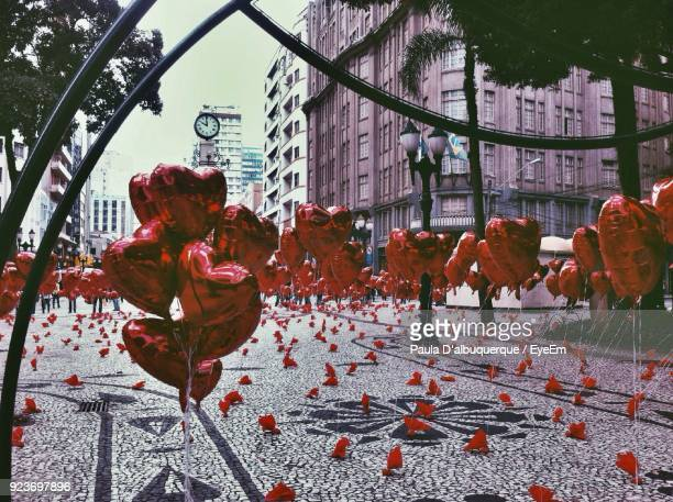 heart shape balloons on footpath against buildings - curitiba stock pictures, royalty-free photos & images