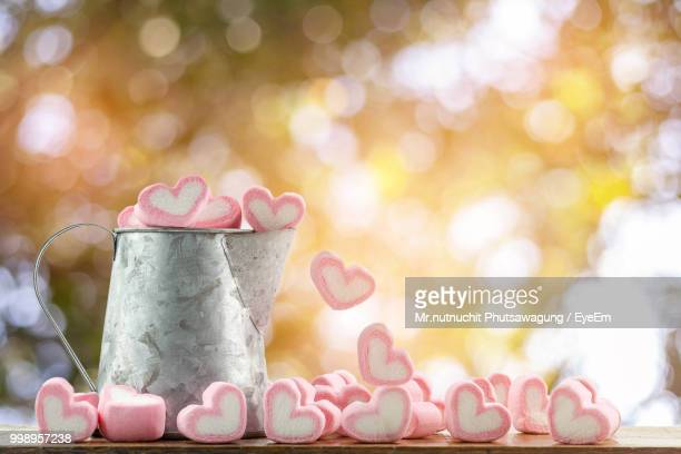 Heart Shape Candies In Container On Table